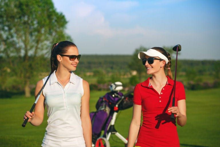 females playing golf