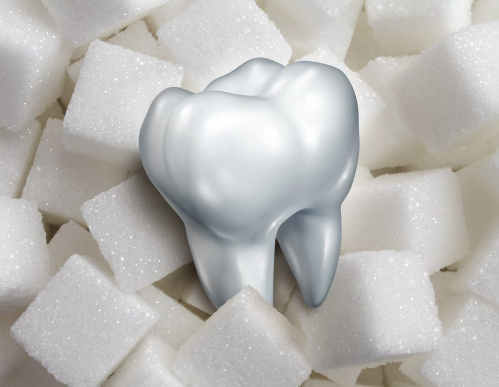 sugar cubes and tooth